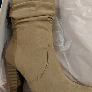 Heeled boots new in box